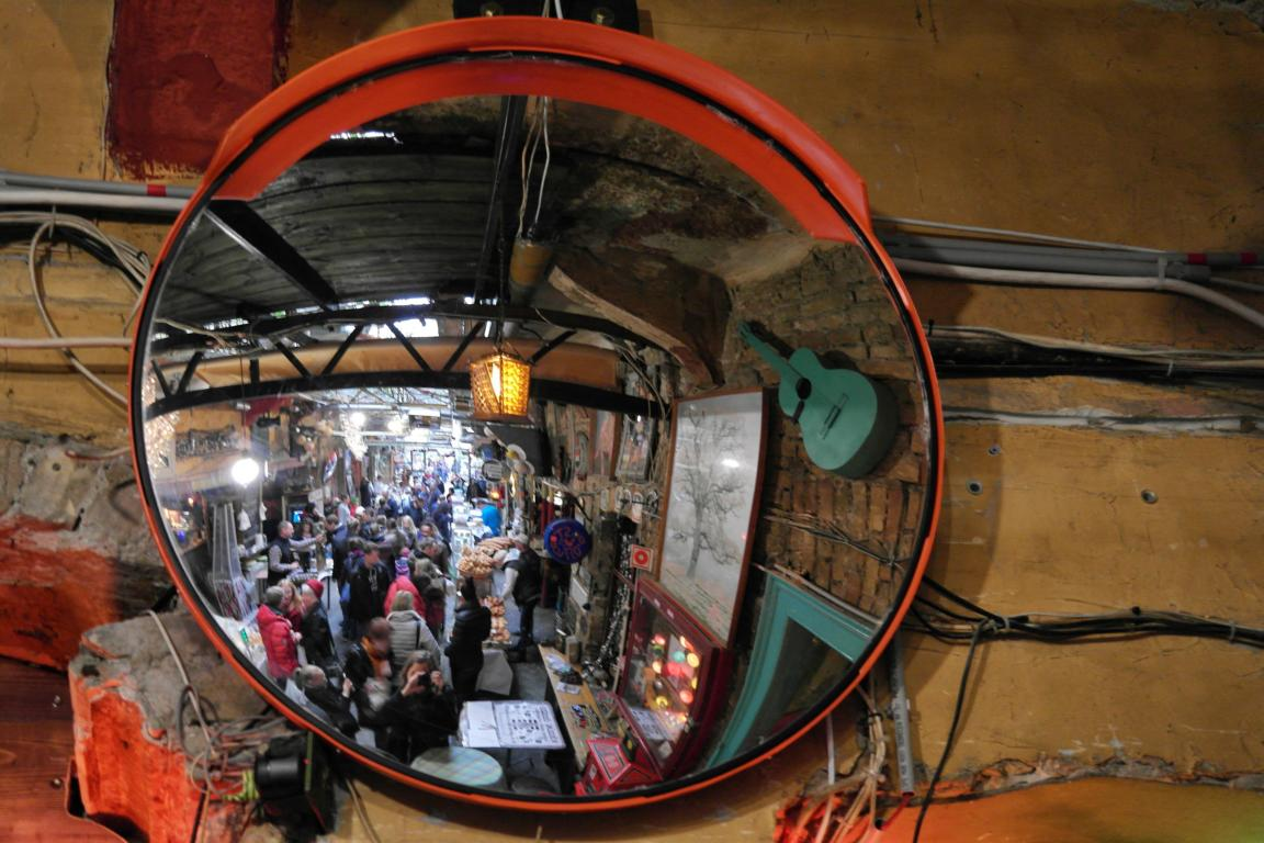 Mirror in Szimpla Kert Ruin Pub reflecting a crowd