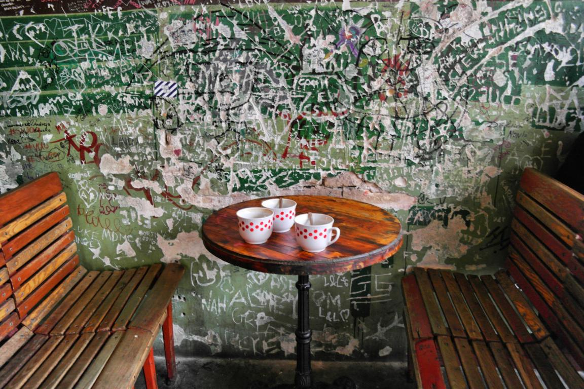 Coffee cups decorated with red dots in Szimpla Kert Ruin Bar